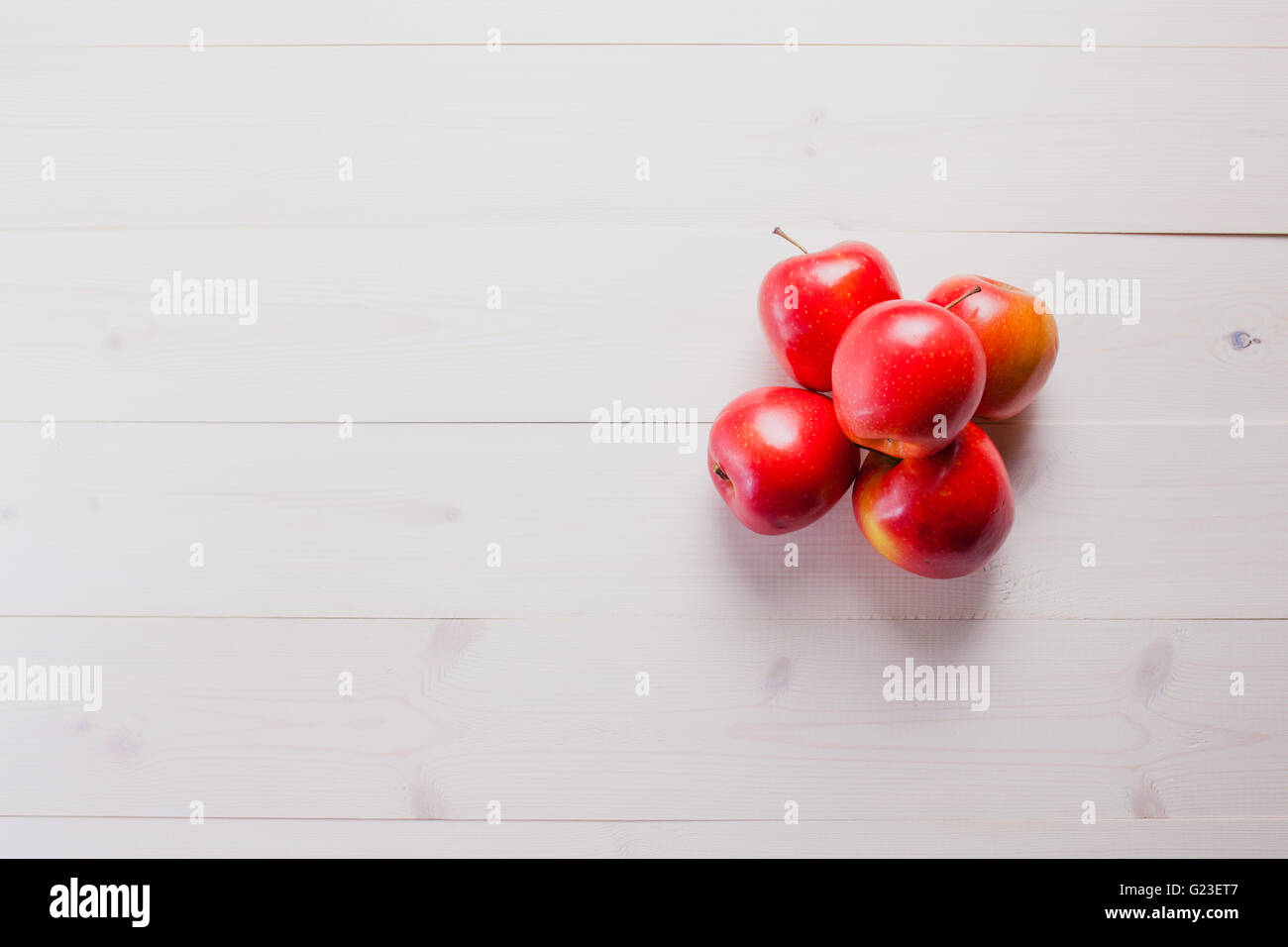 red apples on a white wood table Stock Photo