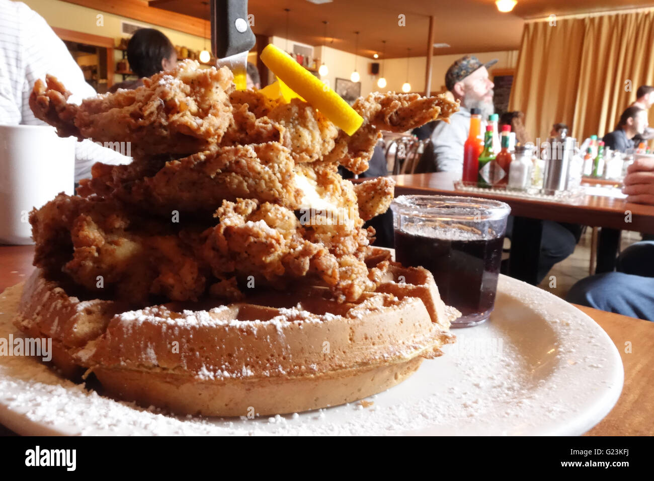 fried chicken waffles inside restaurant - Stock Image