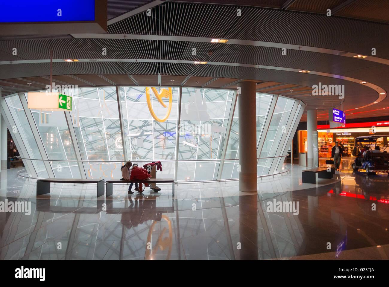 Frankfurt Airport, Germany.  Flughafen Frankfurt am Main, Passengers wait in the departure area. - Stock Image