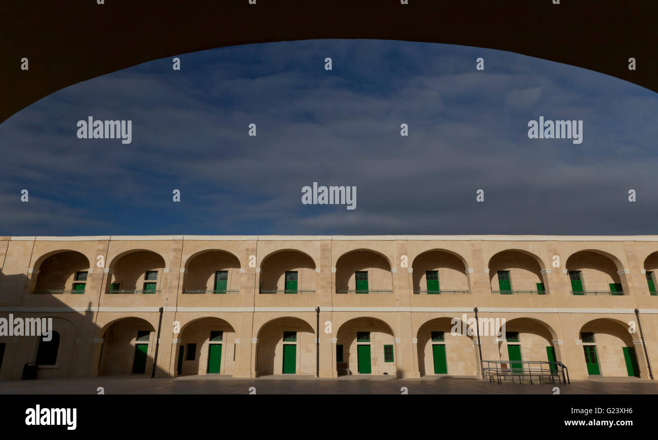 The arcaded row of rooms at Fort St Elmo in Valletta in Malta. - Stock Image