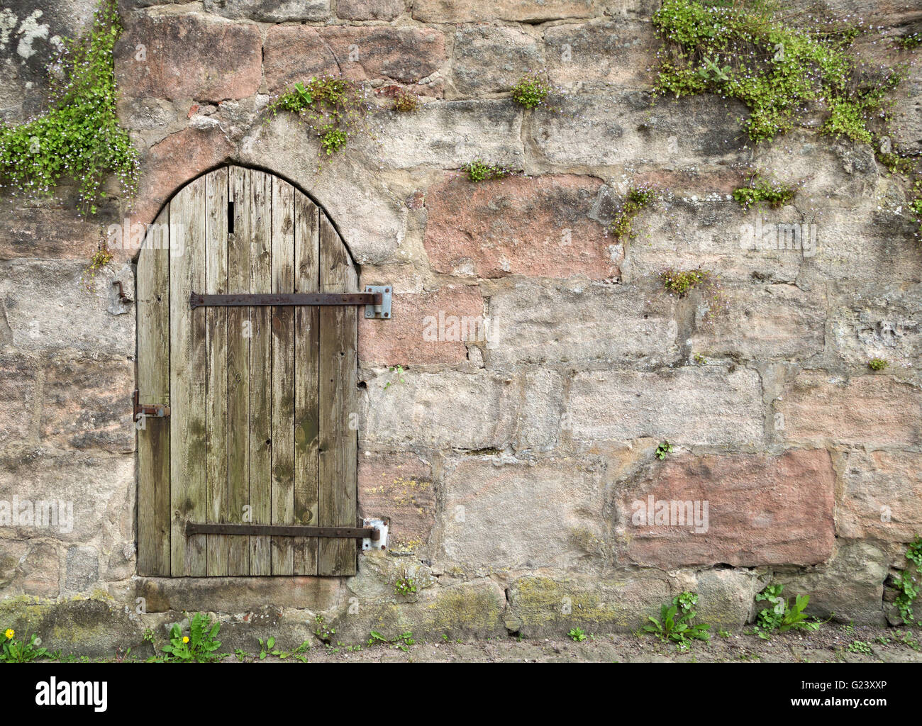 Small Round Wooden Door In An Old Masonry