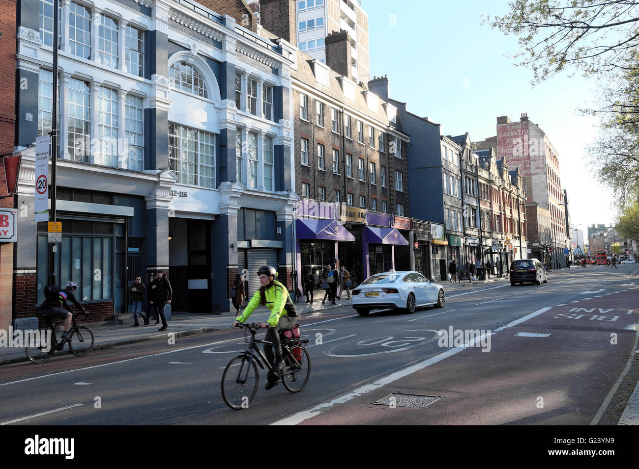 Cyclist and view of Old Street looking west from Silicon Roundabout area towards Clerkenwell East London UK  KATHY - Stock Image