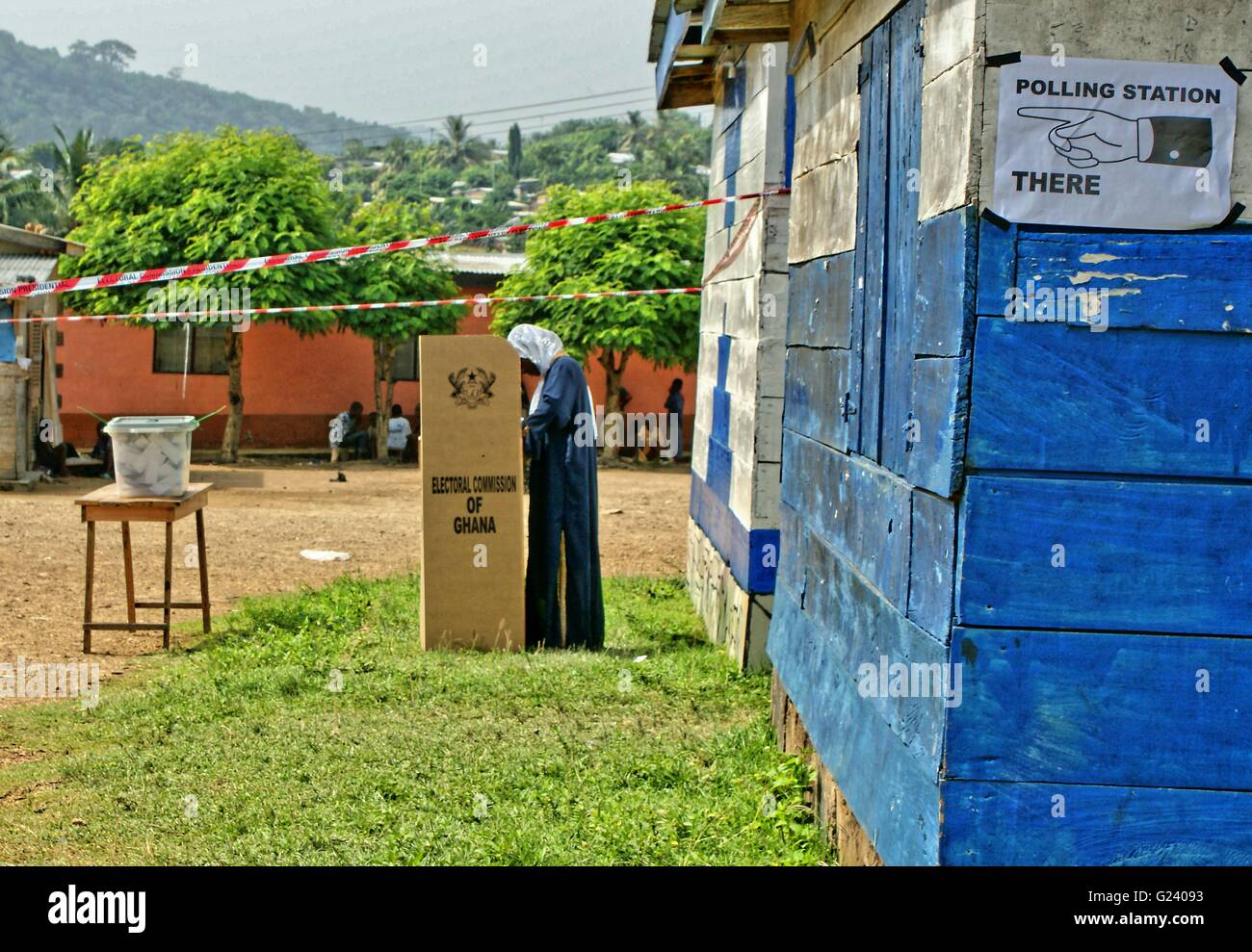 Ghana General Election are on November 7,  2016. Photo of a polling Station, small poster, a women just voting and - Stock Image