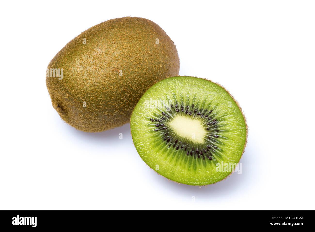 A whole and half kiwi as Cut . - Stock Image