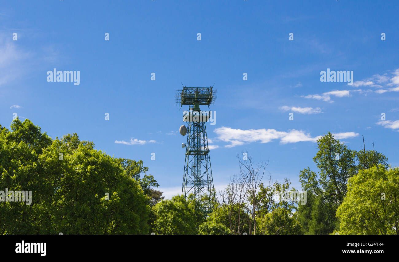 Radio repeater that comes out from the vegetation - Stock Image
