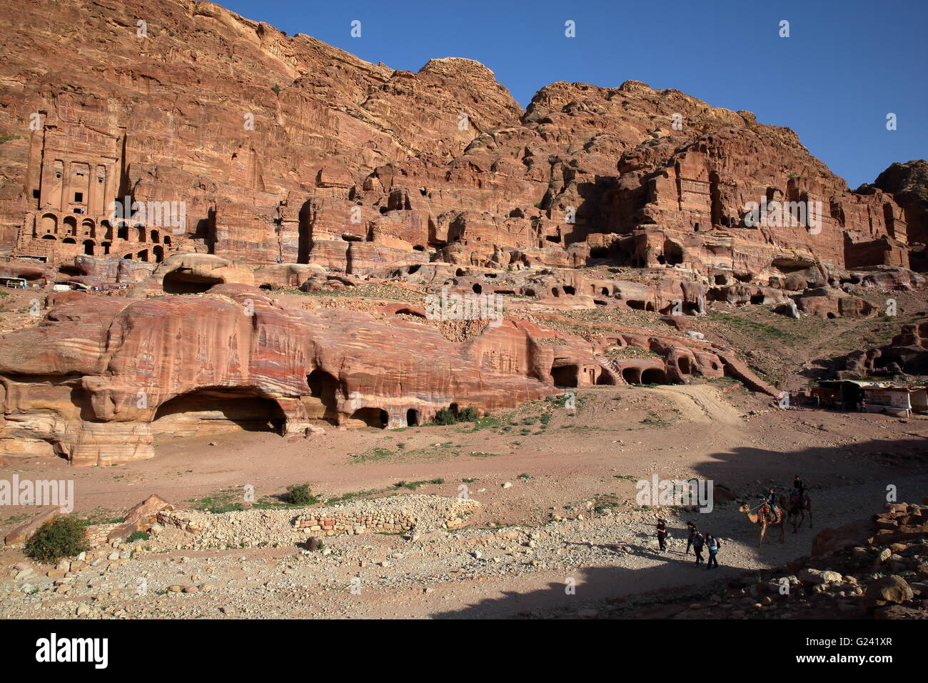 General view of the Royal Tombs in Petra, Jordan, The Urn Tomb on the left side Stock Photo
