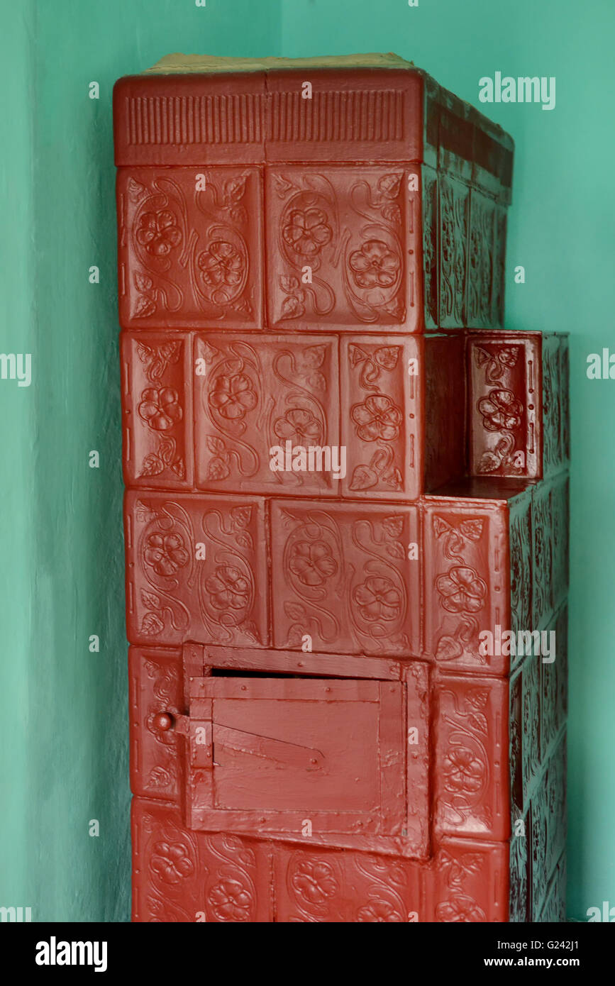 Firebrick old stove in a room in natural light - Stock Image