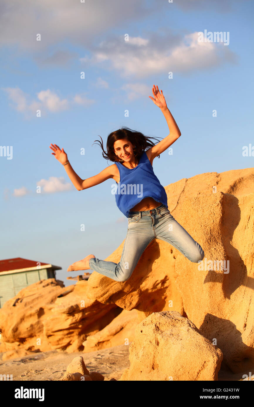 Excited Young twelve year old preteen girl (model release available) - Stock Image