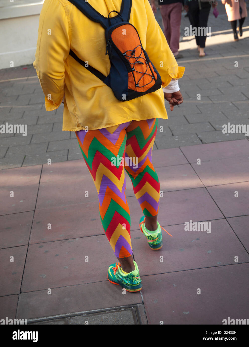 Colorful leggings in Brighton - Stock Image