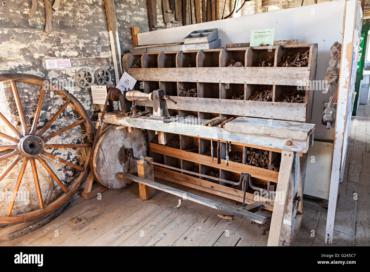 Foot-powered treadle lathe and workbench, Combe Mill, Oxfordshire, UK - Stock Image