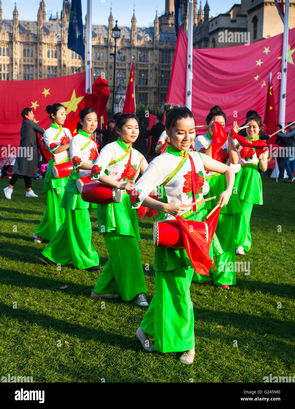 Chinese Dance Troupe performing at Parliament Square, Westminster, London, England. - Stock Image