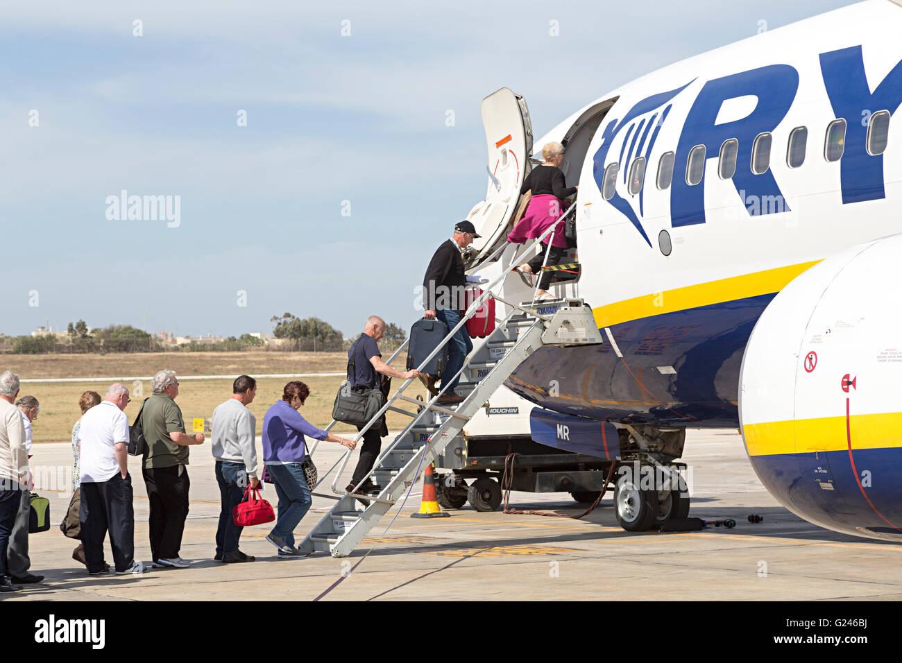 Passengers boarding a Ryanair flight, Malta - Stock Image