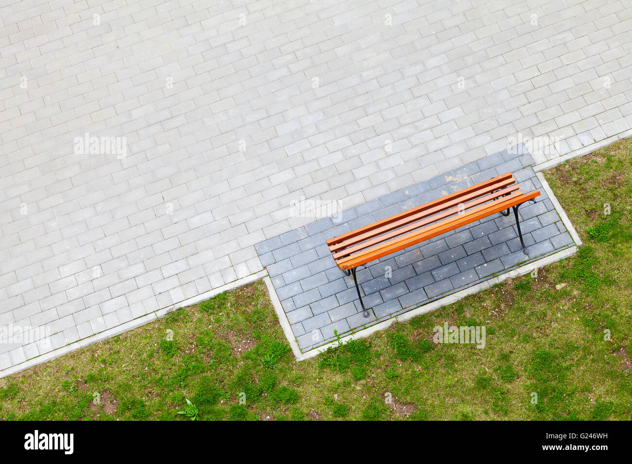 Empty Wooden Bench Stands In Park Near Green Grass Top