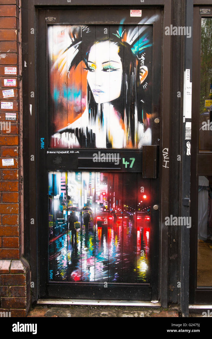 England London East End graffiti of striking woman & night street scene Dan Kitchener Stock Photo