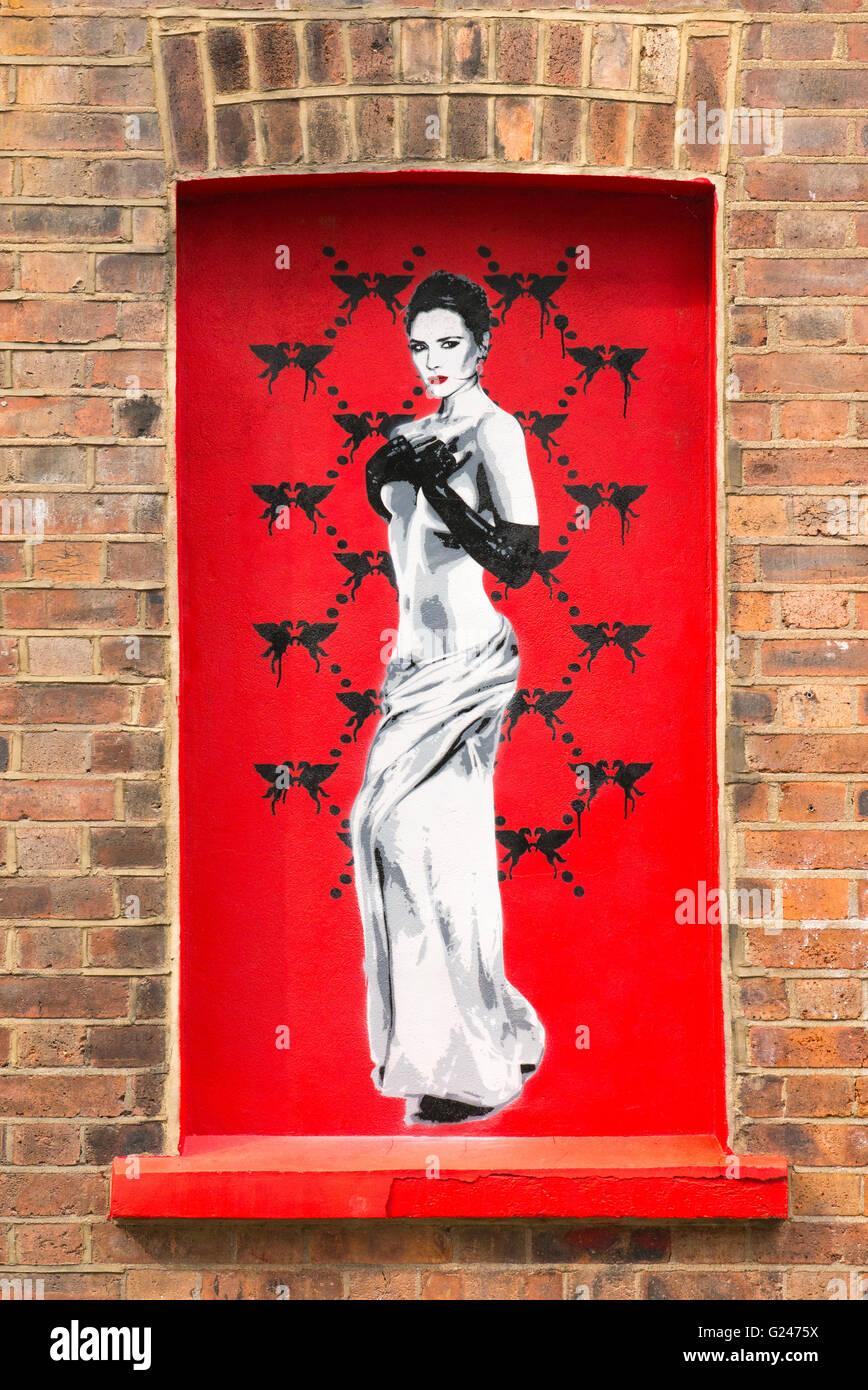 England London East End Princelet Street graffiti artistic picture pretty brunette draped long black gloves Victoria Stock Photo