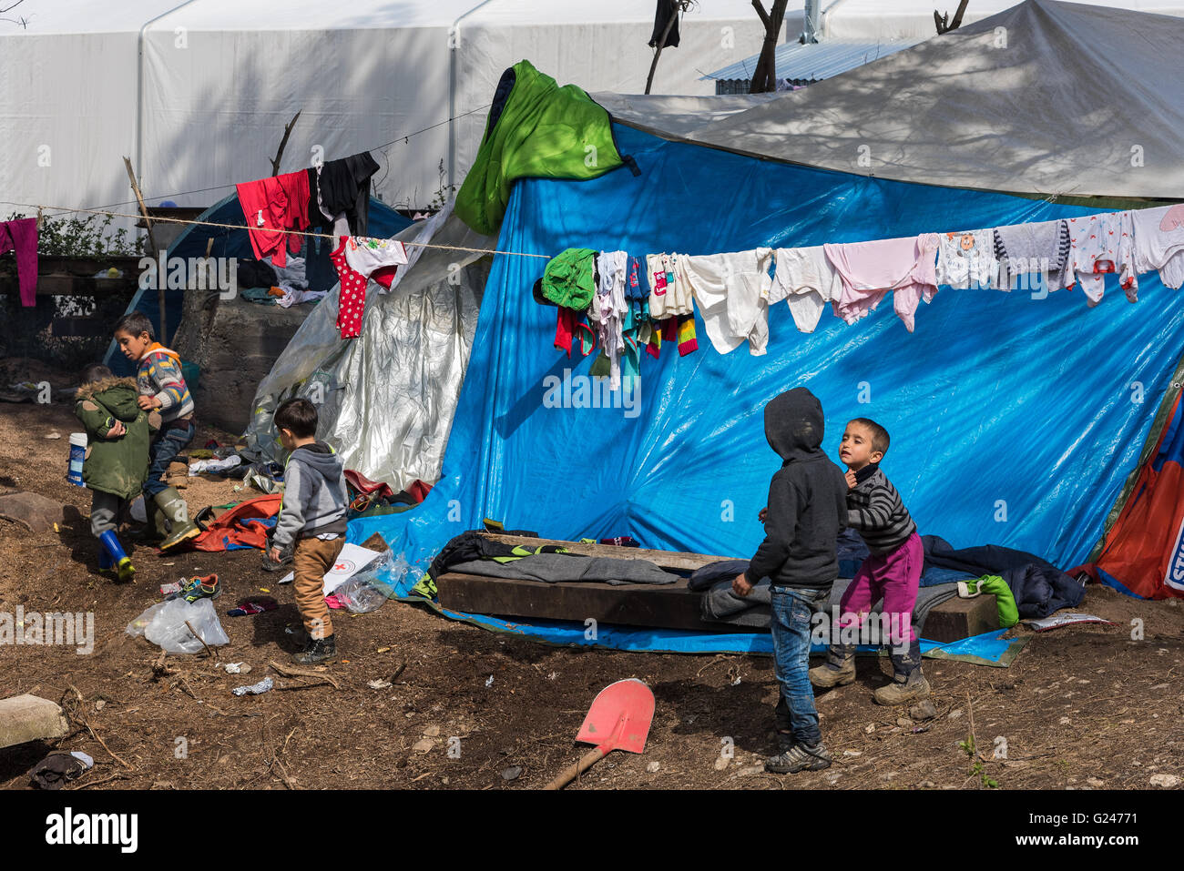 Boys play near their tents on March 17, 2015 in the refugee camp of Idomeni, Greece. - Stock Image