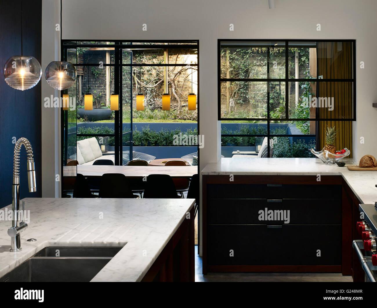 Kitchen, View Of Garden. West London Villa, LONDON, United Kingdom.  Architect: Stiff + Trevillion Architects, 2015.