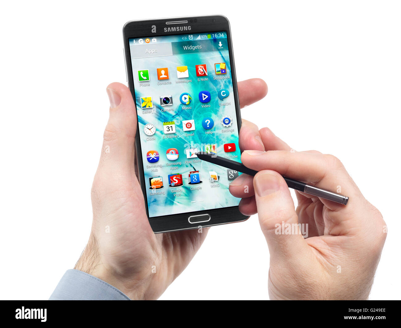 Man's hands with Samsung Galaxy Note III smartphone - Stock Image