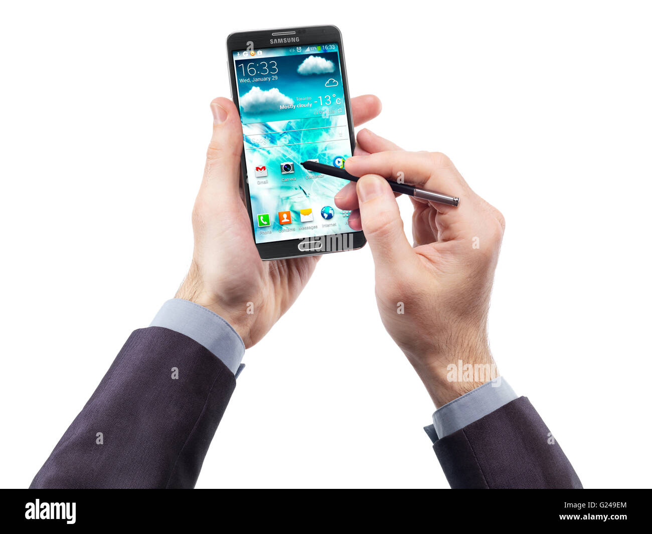 Man's hands with Samsung Galaxy Note III smartphone and a pointer - Stock Image