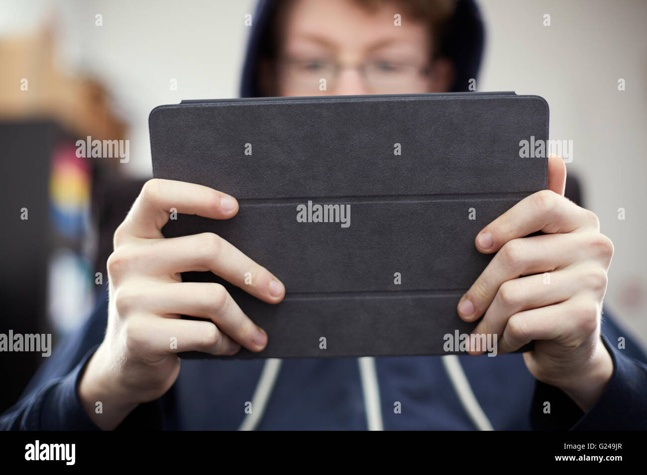 Man with Glasses using Apple iPad - Stock Image
