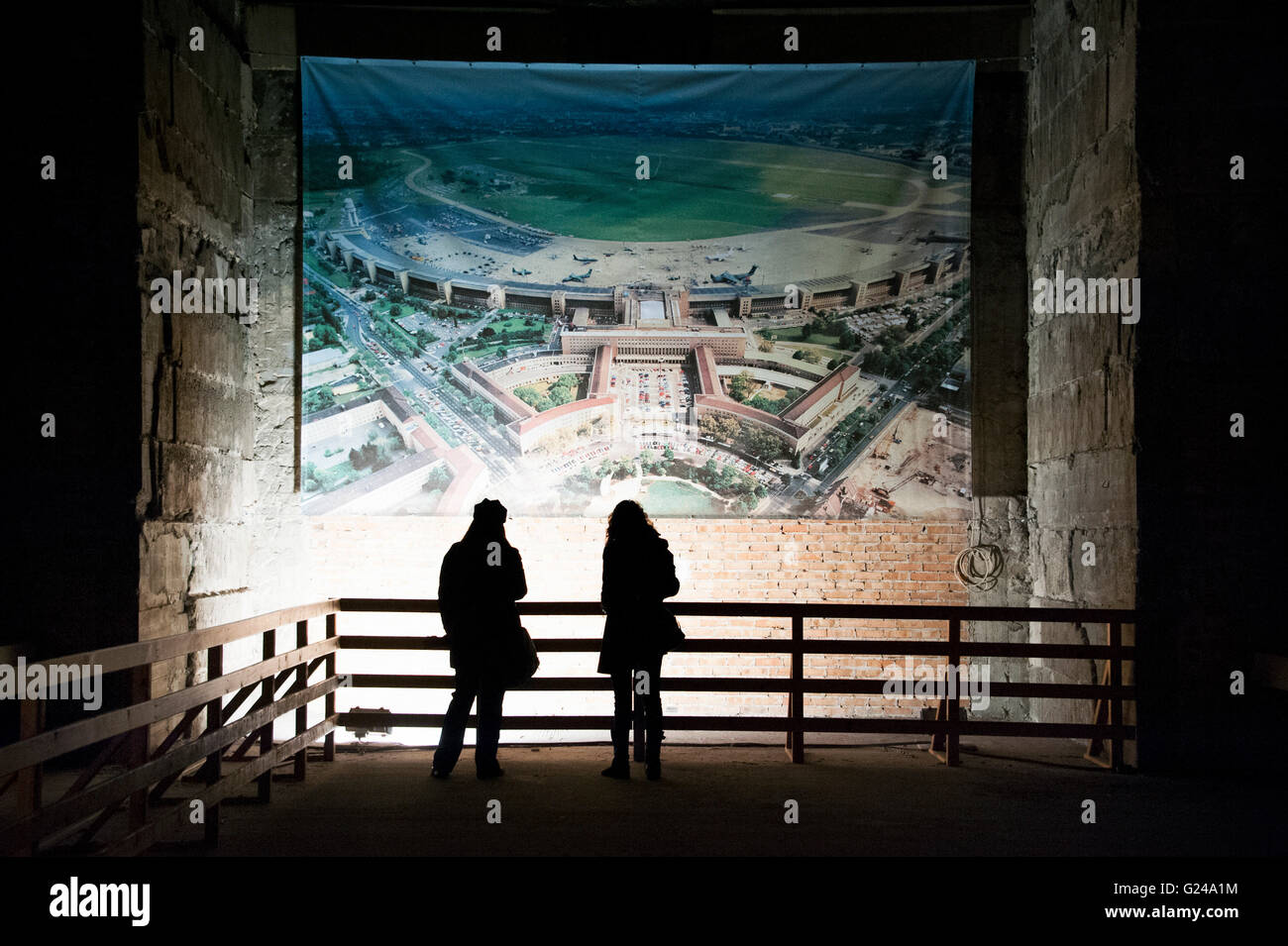 Visitors observing an aerial view of the airport in a large hall, tour of hidden places at Tempelhof Airport, Berlin, - Stock Image