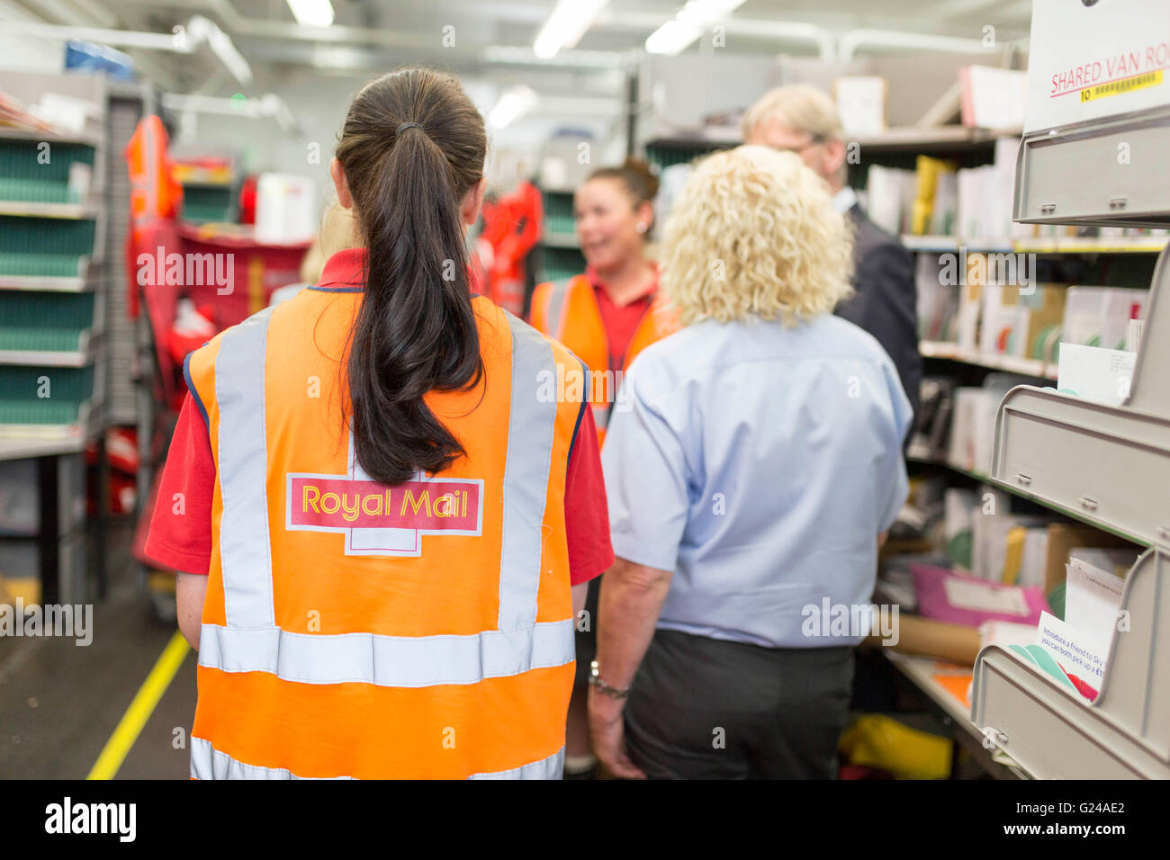 Royal Mail Sorting Office. A woman at work - Stock Image