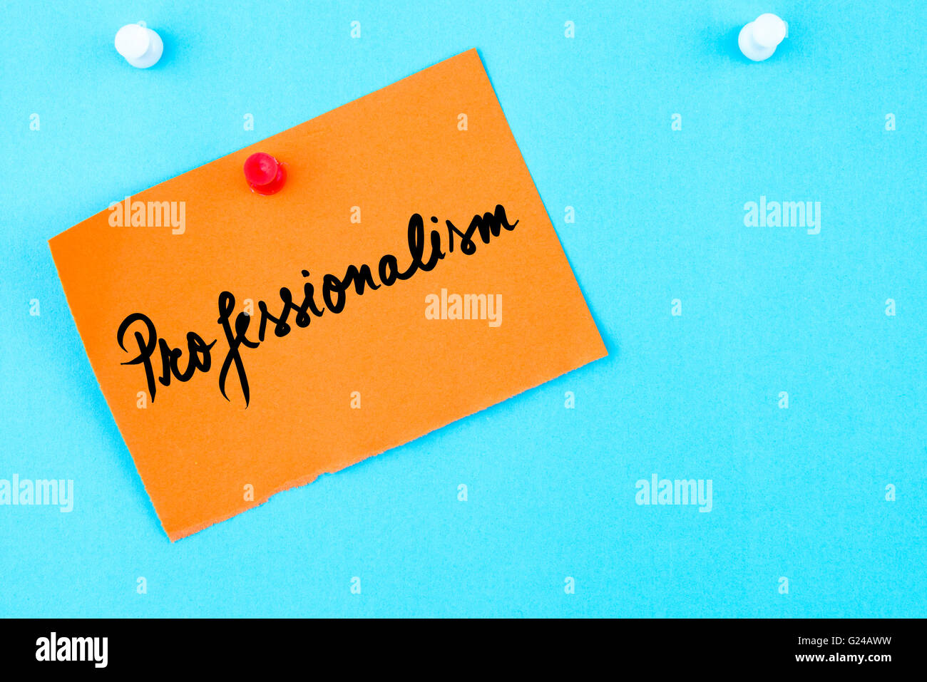 Professionalism written on orange paper note pinned on cork board with white thumbtack, copy space available - Stock Image