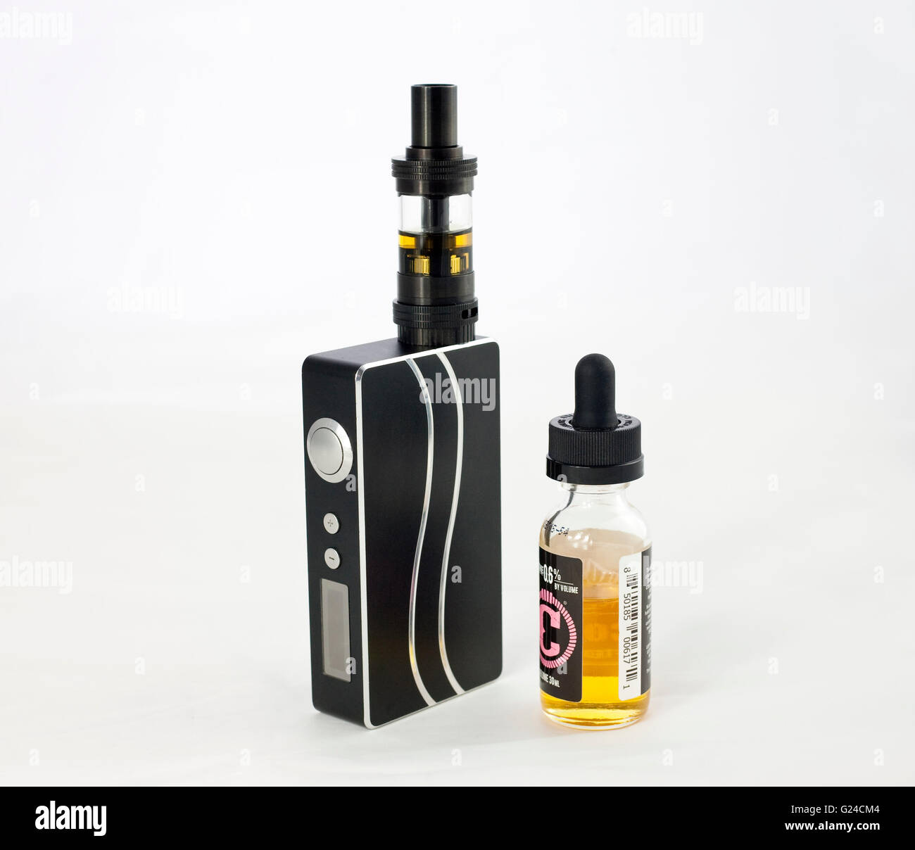 large E cigarette with tank used for vaping alongside a bottle of liquid - Stock Image