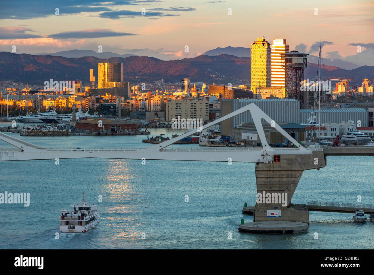 Boat entering the port of Barcelona, Spain - Stock Image
