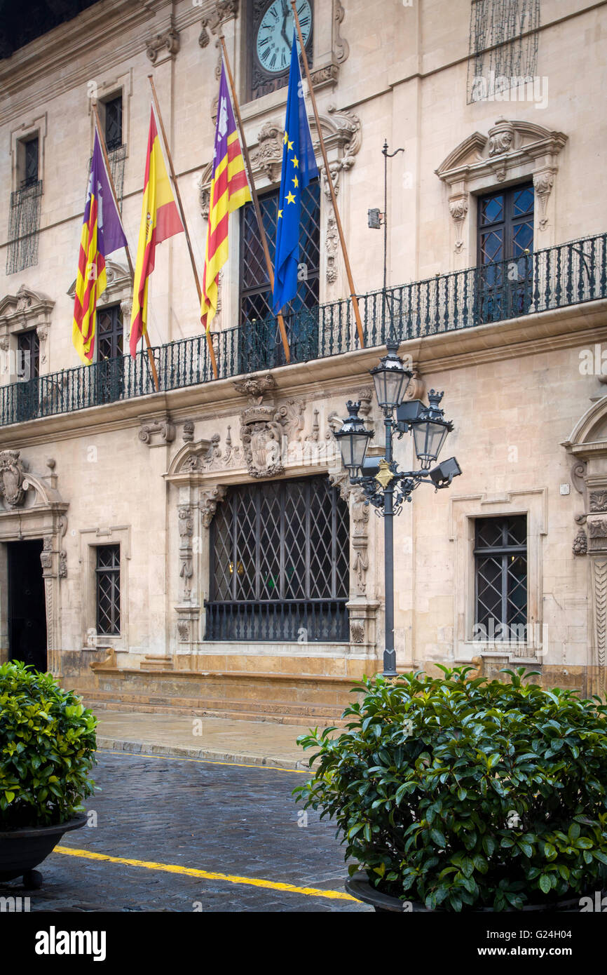 Flags over City Hall at Plaça de Cort, Palma de Mallorca, Spain - Stock Image