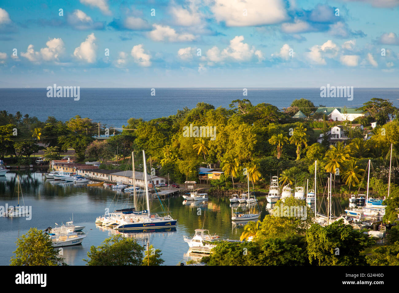 Setting sunlight over the tiny harbor in Castries, St Lucia, West Indies - Stock Image