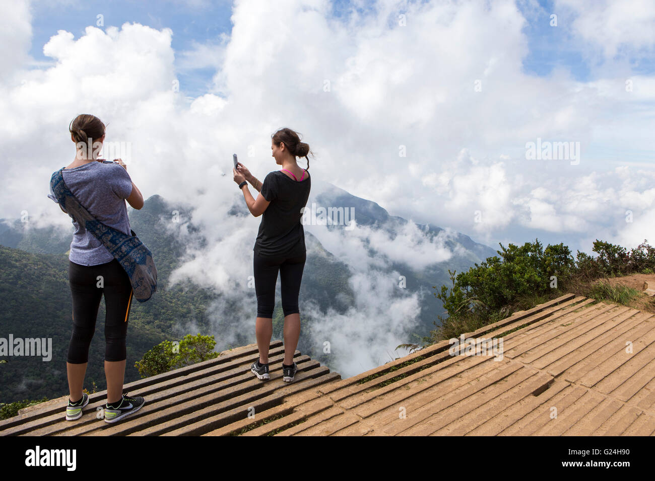 Tourists take photos at World's End which is located in Horton Plains National Park of Nuwara Eliya, Sri Lanka - Stock Image
