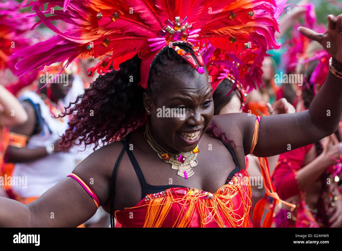 Portrait of dancing woman in costume on Carnival of Cultures (Karneval der Kulturen)  in Berlin, Germany. - Stock Image