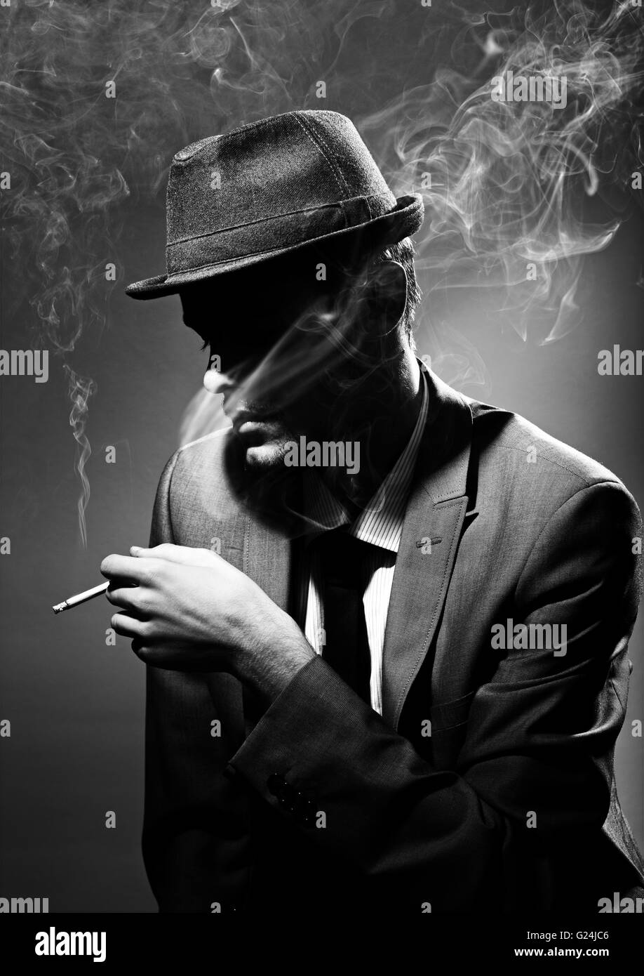 Black and white portrait of a man smoking a cigar stock photo