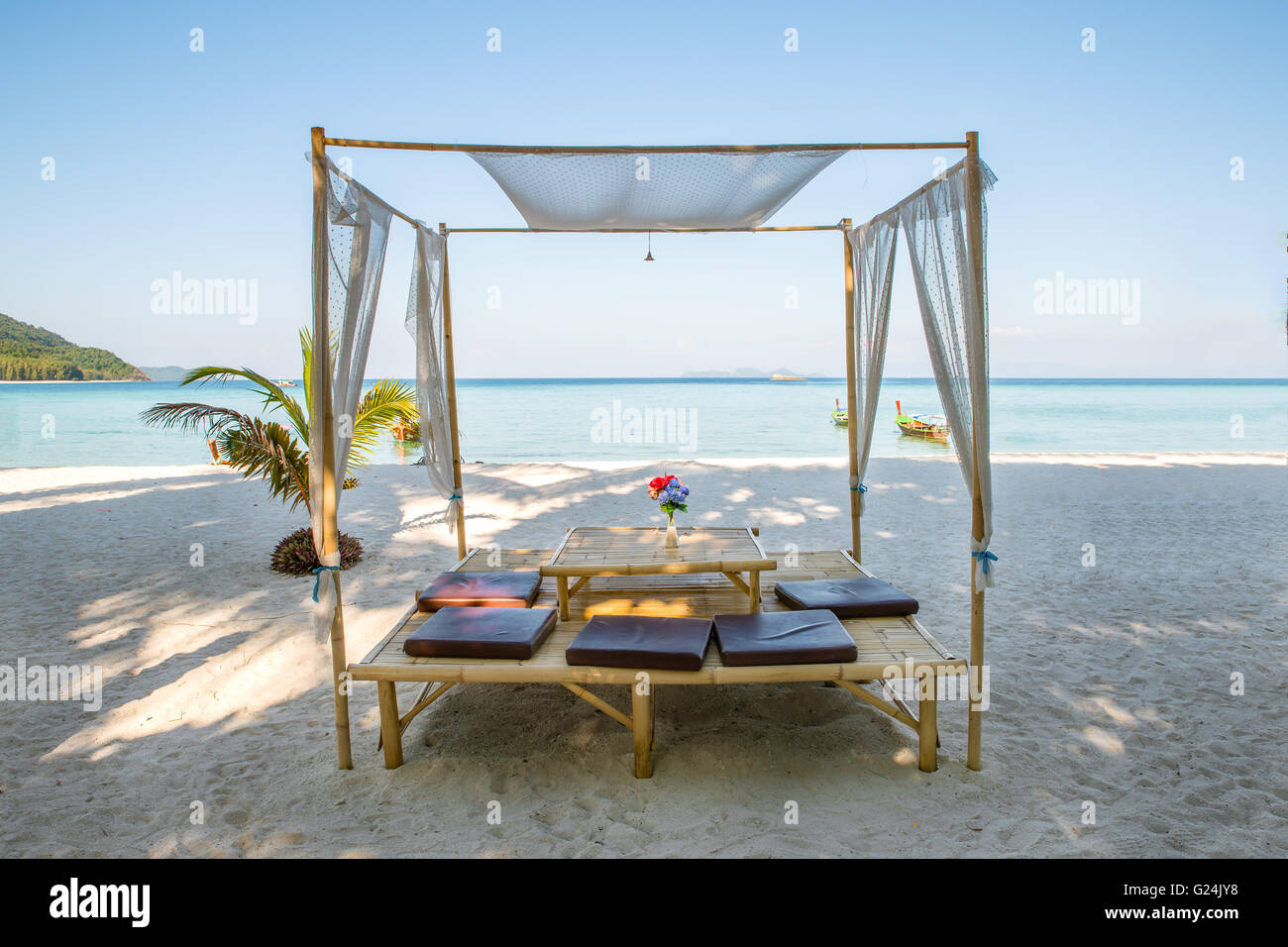 Romantic luxury dinner setting at tropical beach in Phuket, Thailand - Stock Image