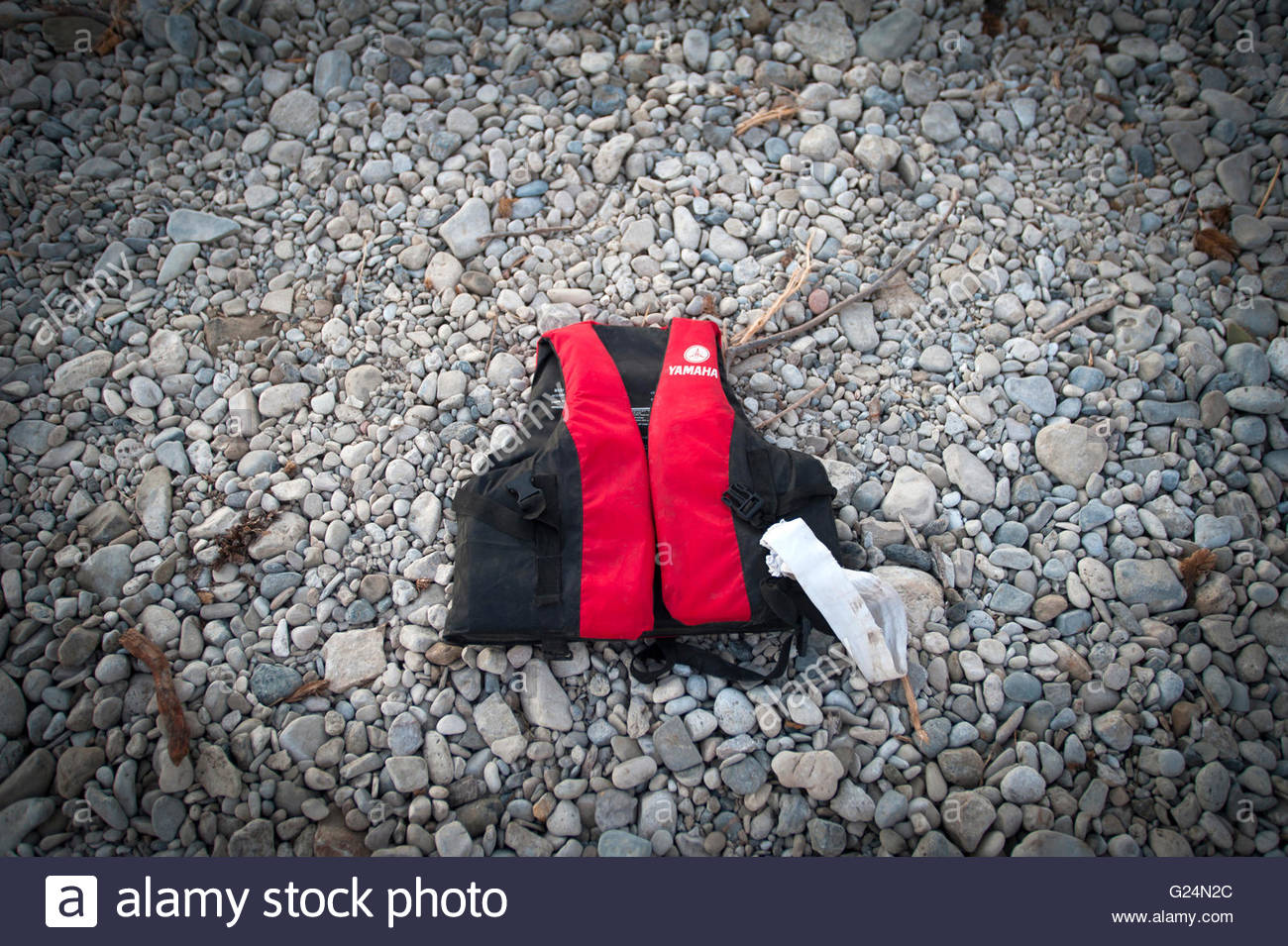 A lone life jacket from a refugee discarded on the beach in Lesbos, Greece - Stock Image