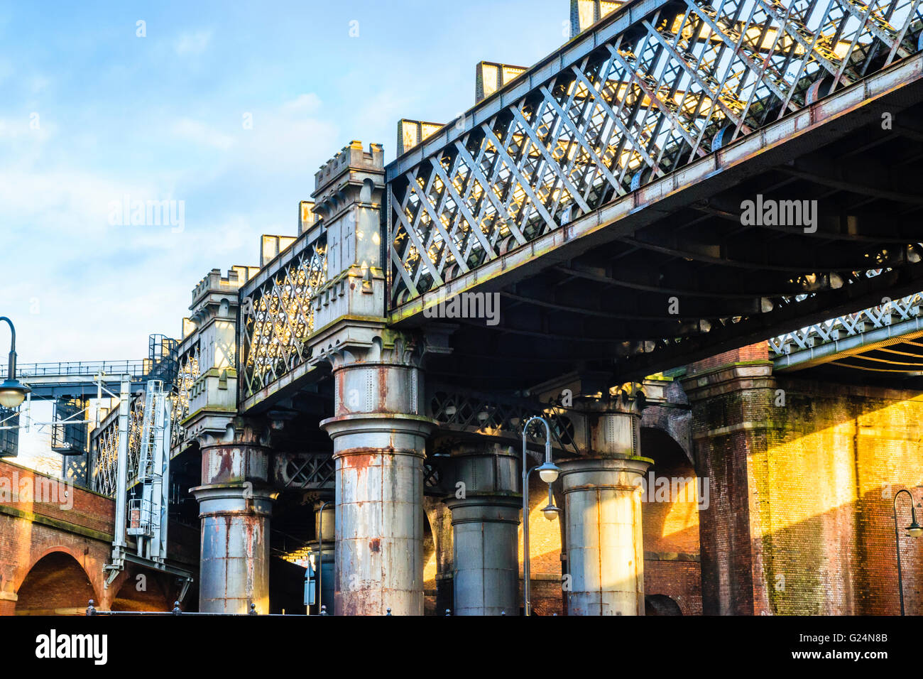 Railway bridges in the regeneration area of Castlefield Manchester - Stock Image