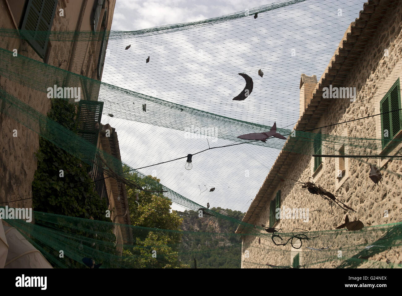 a beautiful wideangle picture of a fishnet decoration in Palma de Mallorca, Spain, seaside, summer, tourism, vacation, - Stock Image