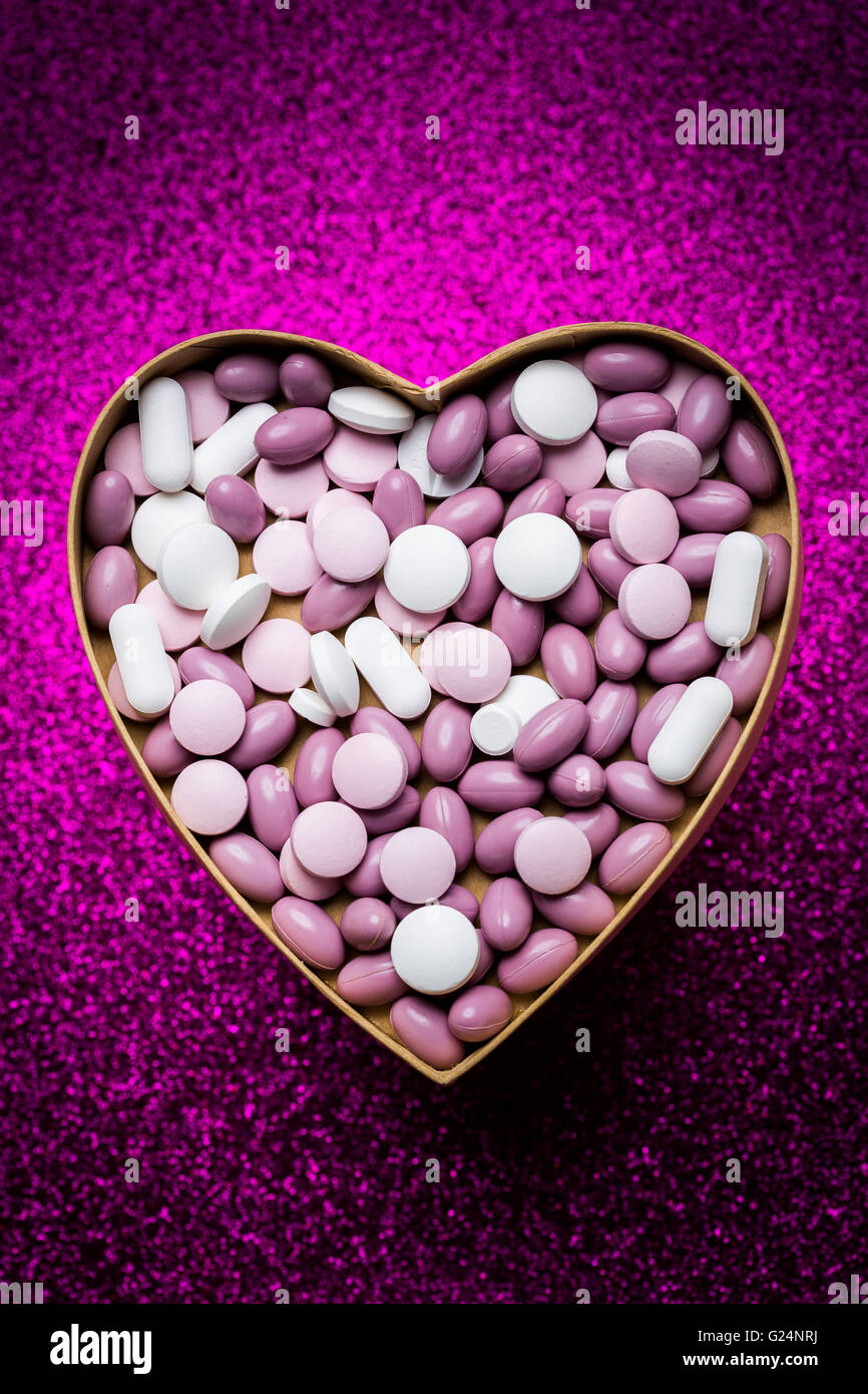Generic pills and capsules in heart shape. - Stock Image