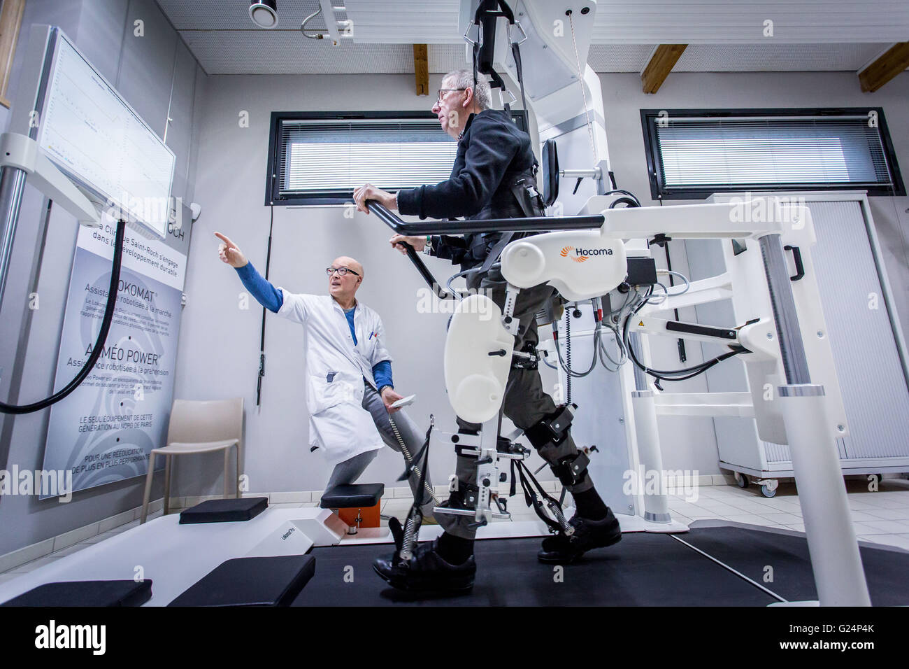 Robotic assistance with walking, Patient with multiple plaqueen rehabilitation session with the Lokomat robot - Stock Image
