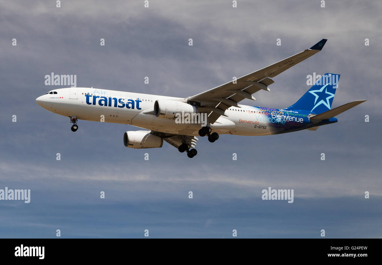 An Air Transat Airbus A330 approaching to El Prat Airport in Barcelona, Spain. - Stock Image