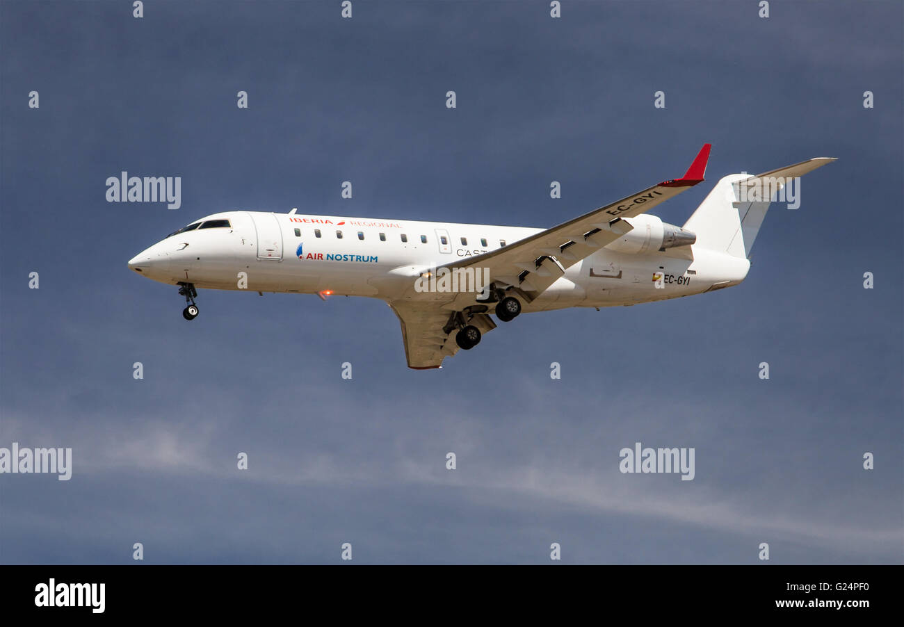 An Air Nostrum Canadair CL-600 Regional Jet approaching to El Prat Airport in Barcelona, Spain. - Stock Image