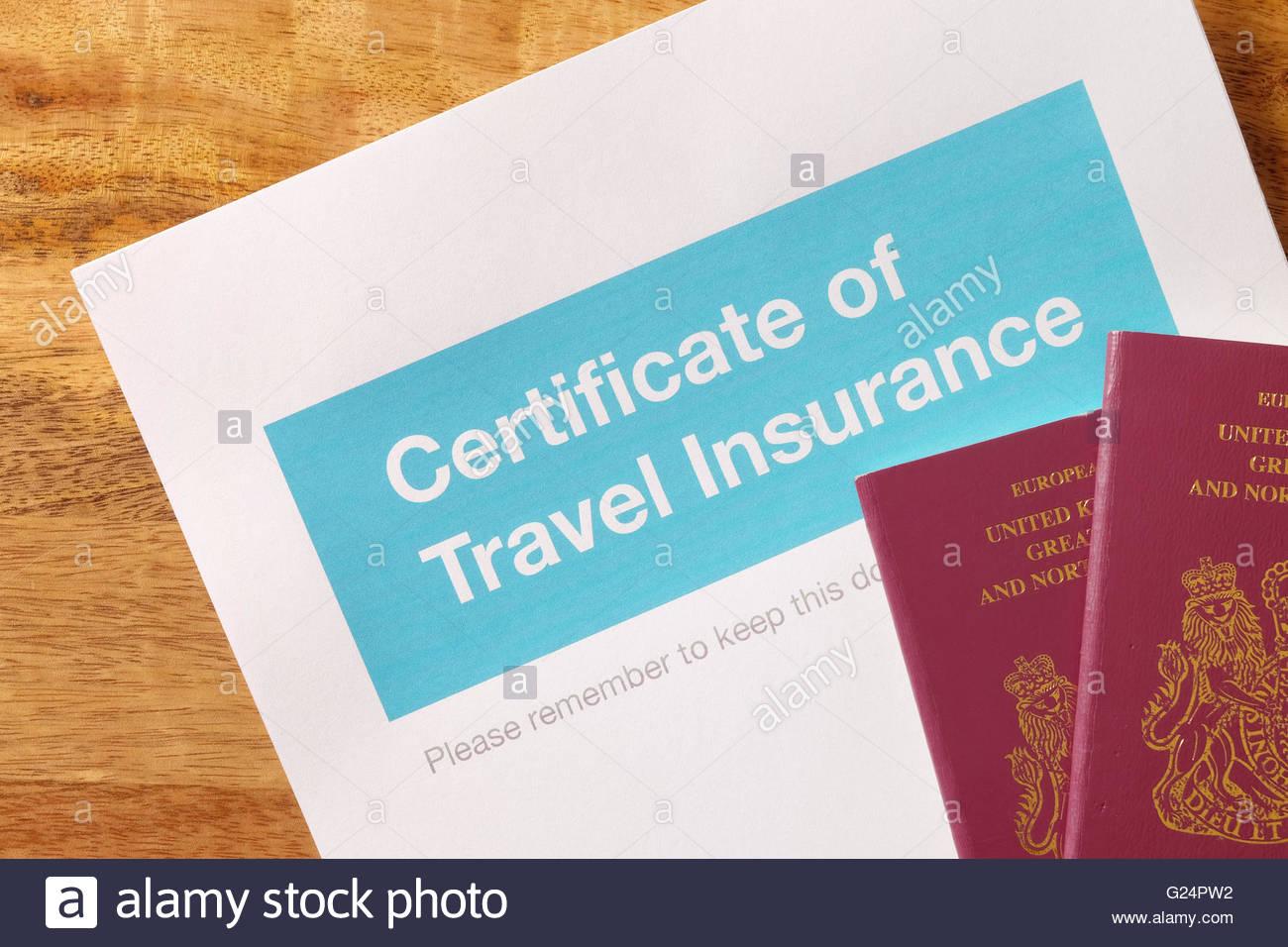 Travel insurance certificate with UK passports - Stock Image