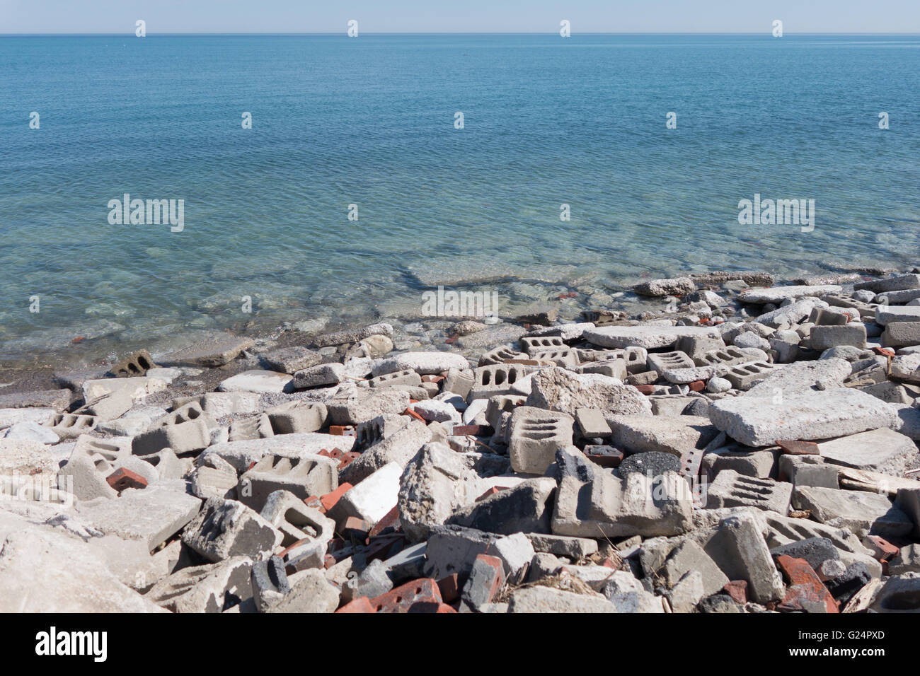 broken concrete blocks bricks dump water - Stock Image