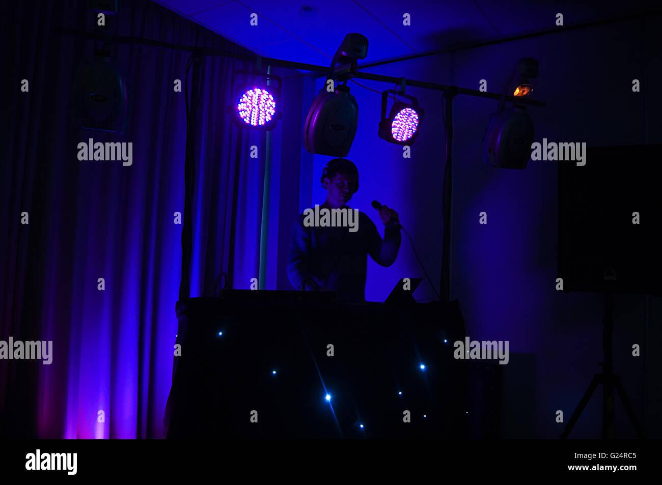 DJ DJing Disc disk jockey jockeys mobile disco discos MC master of ceremonies spining records play playing music - Stock Image