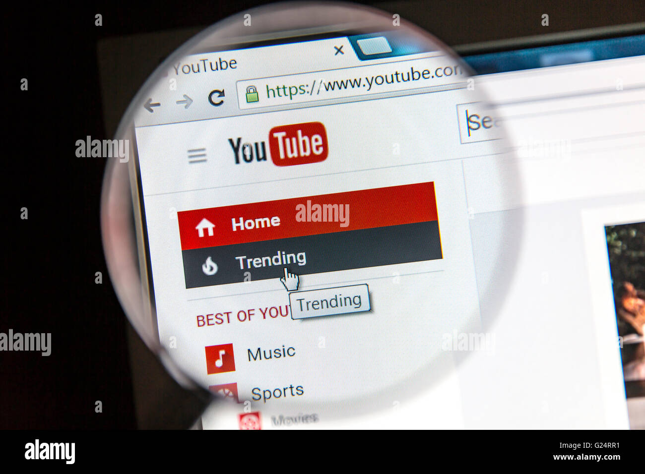 YouTube website under a magnifying glass Stock Photo
