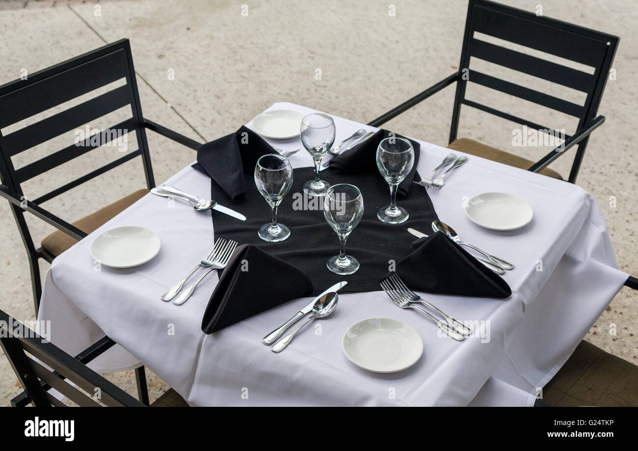 Bistro Table And Chairs With A White Table Cloth And Fancy Place Stock Photo Alamy