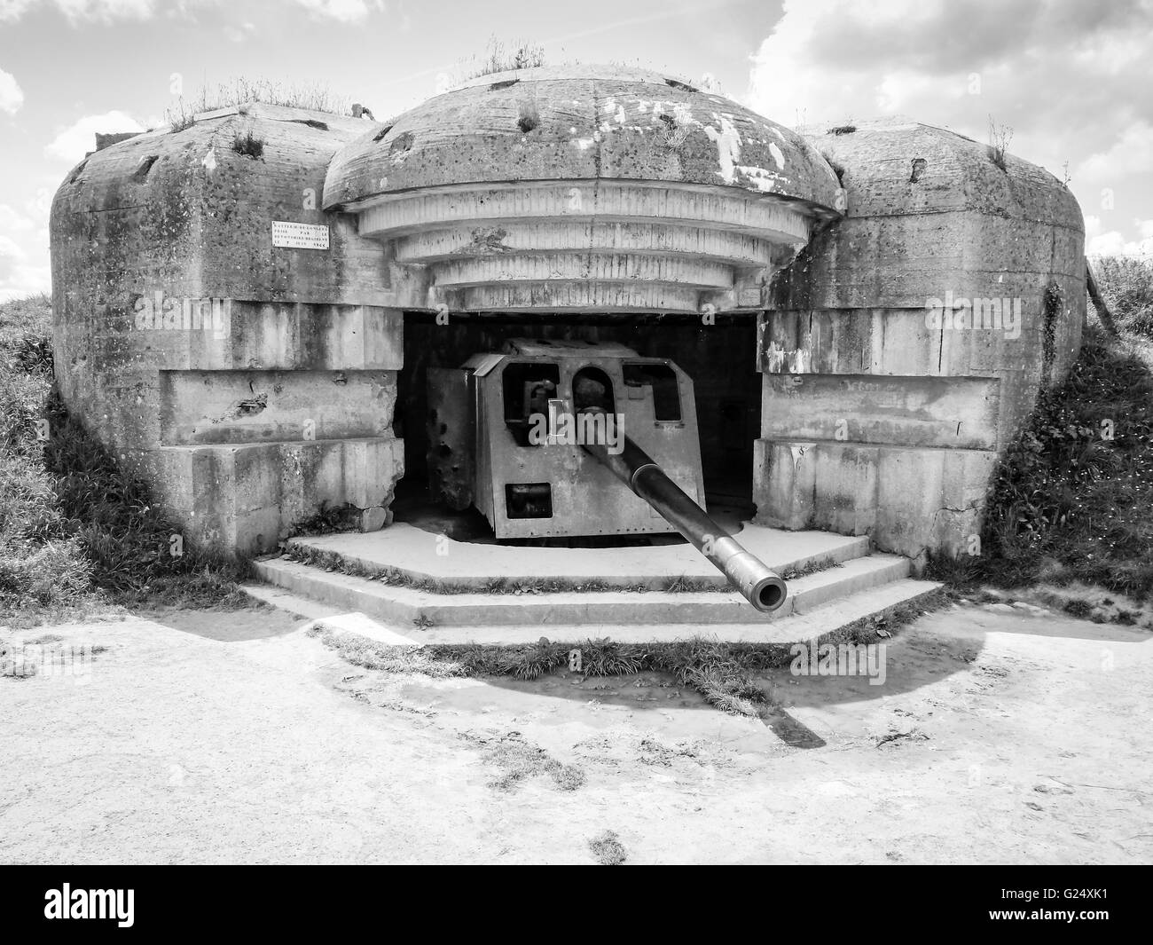 German defense battery against allied troops debarquement, bunker ruins with rusty gun at Longues sur Mer, Normandy, - Stock Image