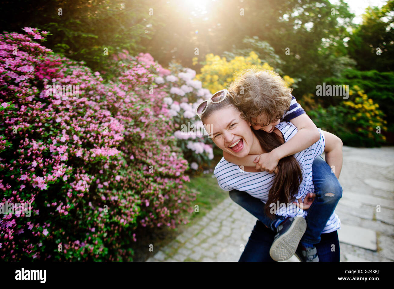 Woman and boy in the park - Stock Image