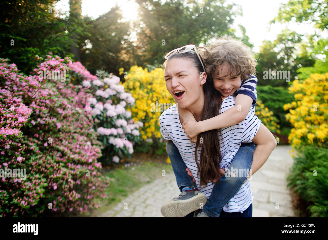 Woman with boy on a walk - Stock Image